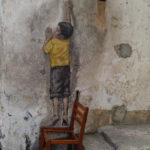 Boy on a chair, Georgetown, Malaisie